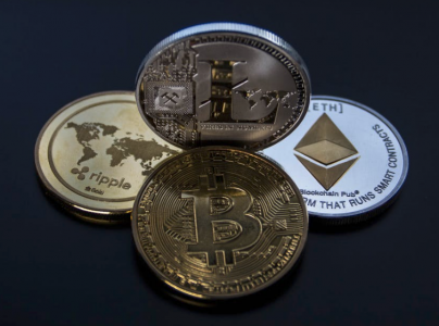 4 assorted cryptocurrency coins